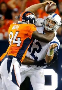 DeMarcus Ware sacks Andrew Luck in Week 1 (AP)