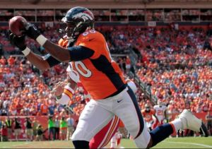 Denver tight end Julius Thomas  pulls in a touchdown pass against Kansas City on Sept. 14 (AP)