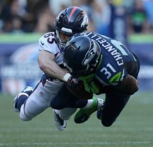 Kam Chancellor breaks up a pass intended for Wes Welker in the third quarter of Seattle's win over Denver on Sept. 21 Getty)