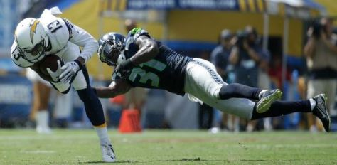Kam Chancellor dives to try to tackle San Diego receiver Keenan Allen on Sept. 14 (AP)