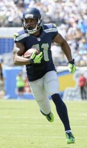Percy Harvin runs for a touchdown in San Diego on Sept. 14 (AP)