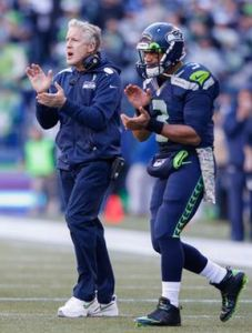 Pete Carroll and Russell Wilson plan to be clapping about their offense a lot this season (Getty Images)