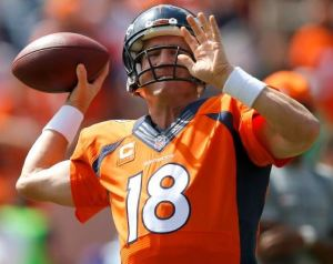 Peyton Manning warms up before the Broncos' 24-17 win over Kansas City on Sunday (AP)