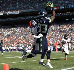 Ricardo Lockette catches a touchdown pass against Aqib Talib during the second quarter Sunday (Getty)