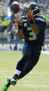 Russell Wilson catches a pass from Jermaine Kearse in the first half against the Denver Broncos on Sept. 21 (AP)