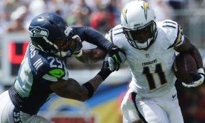 San Diego wide receiver Eddie Royal stiff-arms Earl Thomas on Sunday (AP)