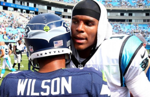 Carolina QB Cam Newton congratulates Russell Wilson after the Seahawks won the season opener on Sept. 8, 2013 (Getty Images)