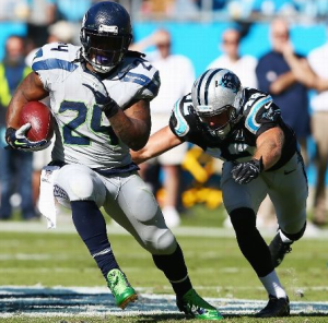 Marshawn Lynch runs against Carolina on Sunday (Getty)