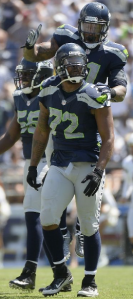 Michael Bennett (72), Bruce Irvin and Cliff Avril (rear) against San Diego in Week 2 (Getty)