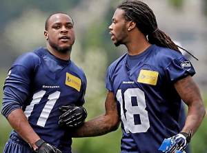 Percy Harvin and Sidney Rice during a minicamp in June (AP)