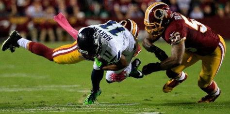 Percy Harvin is tackled by Washington defenders Monday (Getty Images)