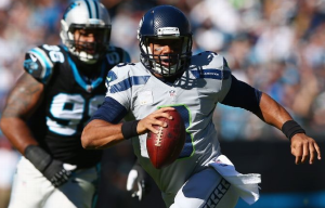 Russell Wilson runs against Carolina on Sunday (Getty)
