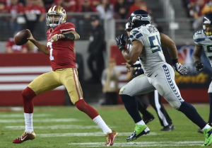 As Bobby Wagner pursues, Colin Kaepernick winds up to throw a ball that ends up intercepted by Richard Sherman (Getty)