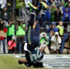 Marshawn Lynch goes head over heels in the end zone vs. the Giants (Getty)