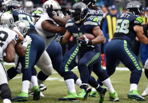 Marshawn Lynch runs with the ball during the first quarter against the Oakland Raiders (Getty Images)