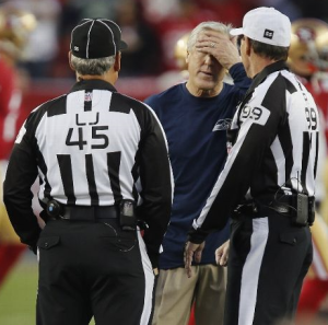 Pete Carroll talks with line judge Jeff Seeman and referee Tony Corrente before Seattle's game at Levi's Stadium in Santa Clara, Calif. (Getty)