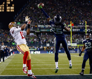 Richard Sherman tips a pass intended for Michael Crabtree in the NFC Championship Game last season (Getty)