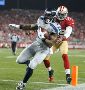 Robert Turbin scores as Chris Culliver chases him in the first quarter (Getty)