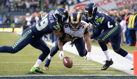 Earl Thomas punches the ball out of the hand of Benny Cunningham at the goal line, saving a TD and giving the Seahawks the ball (Seahawks.com)
