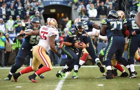 The Seahawks' offensive line struggles to protect Russell Wilson against the 49ers in Week 15 (Seahawks.com)