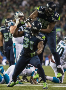 Kam Chancellor and Tony McDaniel celebrate a stop vs. Carolina on Saturday (Seahawks.com)