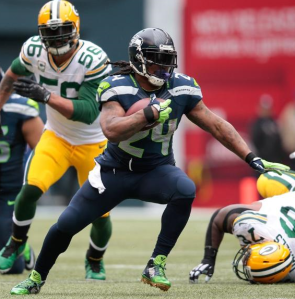 Marshawn Lynch runs against the Packers in the NFC title game (Seahawks.com)
