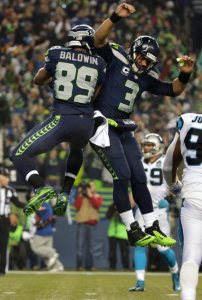 Russell Wilson and Doug Baldwin celebrate a 16-yard TD hookup vs. Carolina (Seahawks.com)