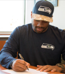 Wilson signing contract