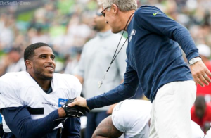 Bobby Wagner and Pete Carroll shake hands before practice (The Seattle Times via Twitter)